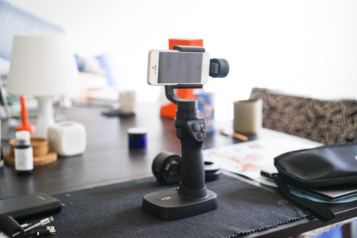 A desk with a remote control