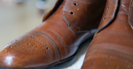 A close up of a pair of brown shoes