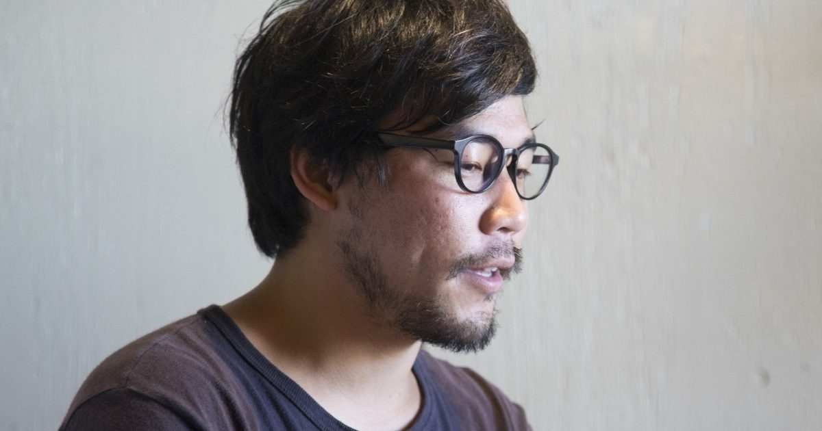 A man in glasses looking at the camera